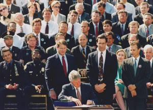 President Clinton signing the 1994 assault weapons ban