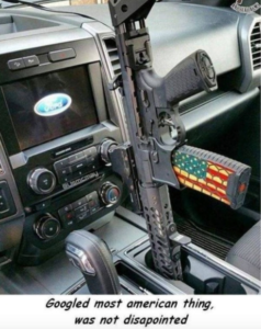 Yes, it's a car holster, and it's very, very American, but it's still a bad idea