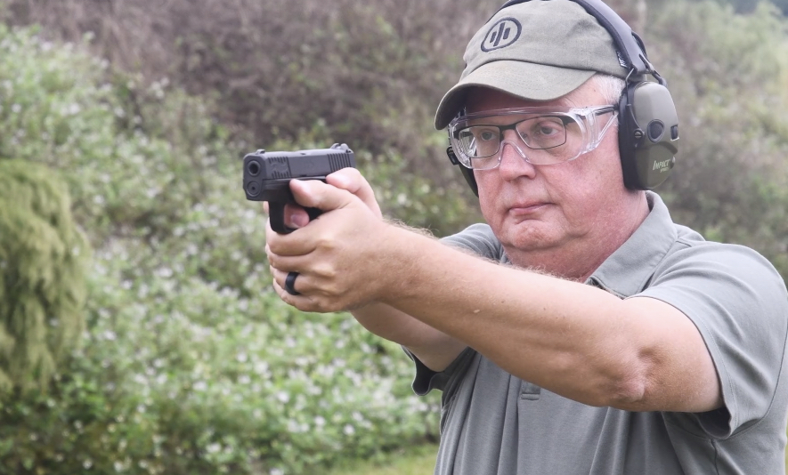 The author firing the Walter PPS M2 pistol at the shooting range