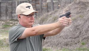 The author firing the Sccy CPX-2 at a shooting range as part of his review