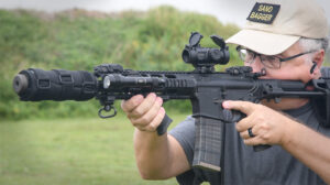 The author demonstrating scope eye relief at a shooting range