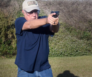 Sights on target while demonstrating a concealed carry draw