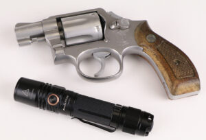 Tactical Flashlight and firearm