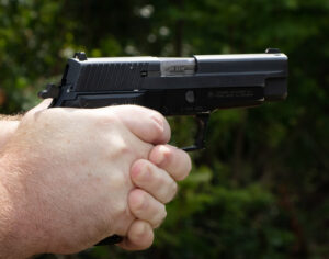 The author pulling the trigger on a Hammer-fired Colt 1911