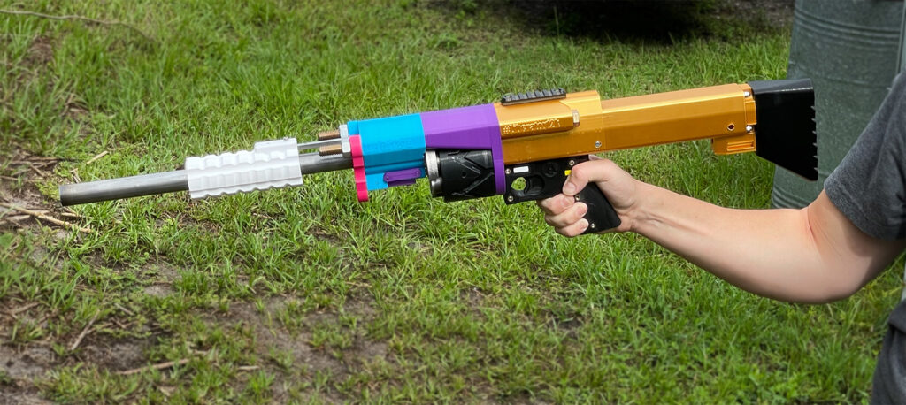 A competitive shooter demonstrates a 3D printed shotgun
