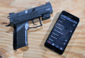Mantis X10 system and pistol and app for a smartphone displayed