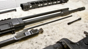 Gas piston AR-15 disassembled on a table
