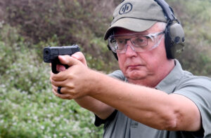 The author demonstrating how to hold a pistol