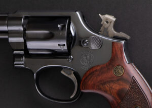 A revolver with a hammer that you can manually cock shown.