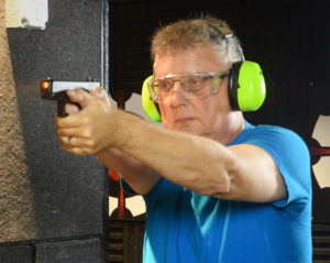 Kevin, the author, shooting a Glock 19