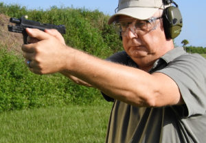 At the range, shooting the Smith & Wesson Shield 380 EZ Review